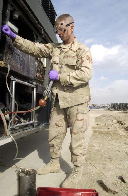 BAGRAM AIR BASE, Afghanistan -- Staff Sgt. Robert Armentrout takes a fuel sample to check for water particles.  Armentrout is a fuels specialist assigned to the 455th Expeditionary Operations Group.  (U.S. Air Force photo by Tech. Sgt. Brian Davidson)