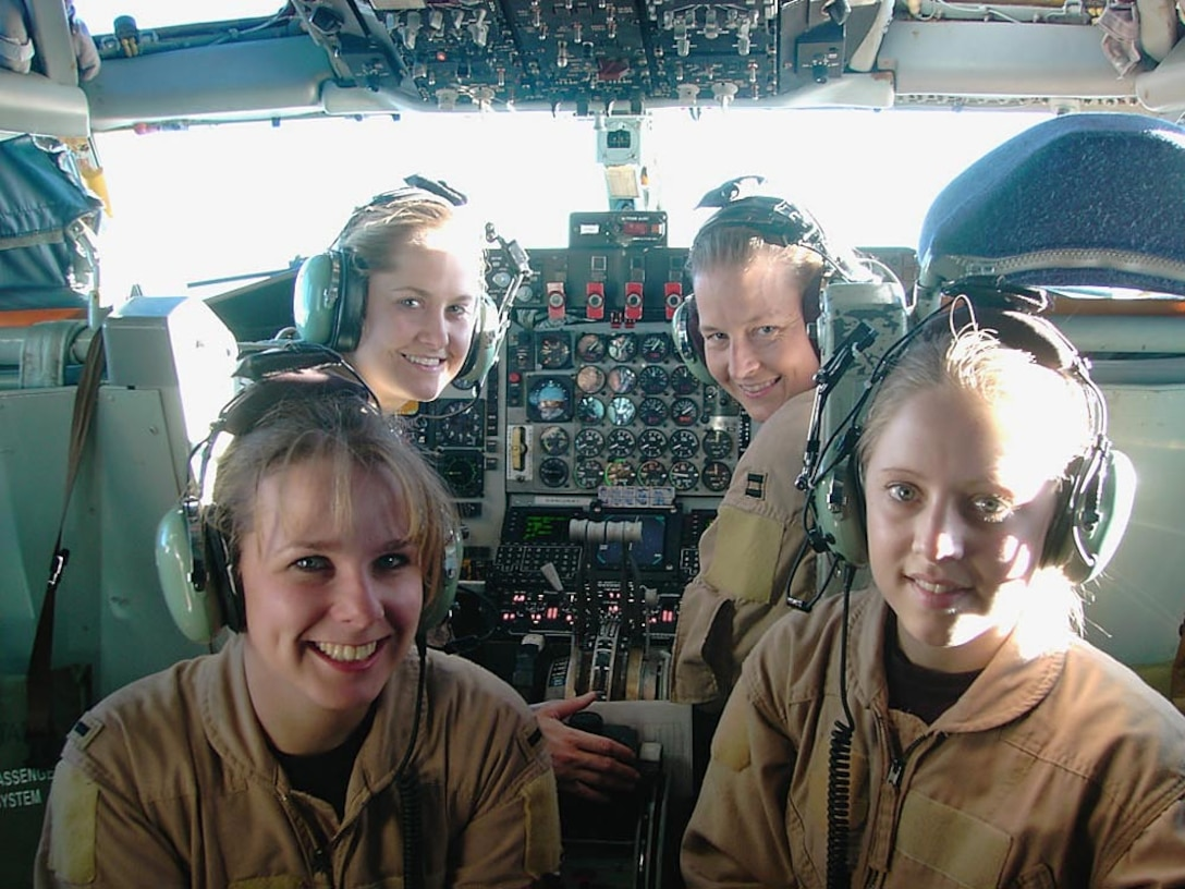 OPERATION ENDURING FREEDOM -- (Clockwise from lower left) 1st Lt. Alison, Capts. Heather and Waynetta and, Senior Airman Lyndi, all from the 376th Expeditionary Air Refueling Squadron, flew an all-female KC-135 Stratotanker air refueling mission over Afghanistan on Jan. 31. (U.S. Air Force photo by Capt. Elizabeth Ortiz)