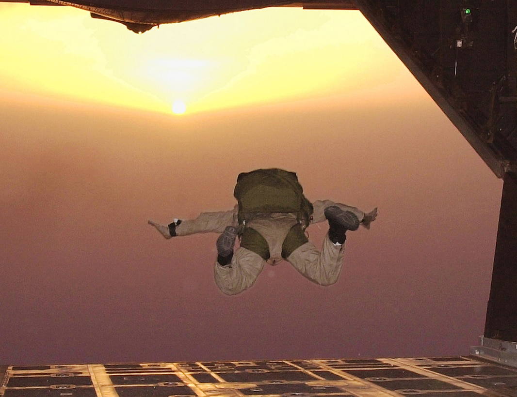 AHMED AL JABER AIR BASE, Southwest Asia -- Staff Sgt. David Risnear, a combat controller and jumpmaster with the Air Force Special Operations Detachment here, catches some air after jumping from the back of an MC-130E Combat Talon II.  The HALO (High Altitude, Low Open) jump included members of the 332d Expeditionary Security Forces Squadron, AFSOD and others from Camp Doha. (U.S. Air Force photo by Tech. Sgt. Steve Elliott)
