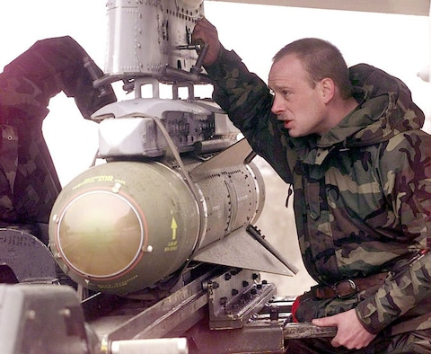 1990's -- GIOIA DEL COLLE, Italy -- Staff Sgt. Todd Kenny helps position an AGM-65 Maverick missile underneath the wing of an A-10 Thunderbolt II.  Kenny, of Lake Luzerene, New York, is part of the 81st Expeditionary Fighter Squadron. The 81st EFS is based at Spangdahlem Air Base, Germany, and is supporting NATO Operation Allied Force.
