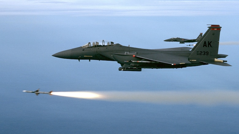 OVER THE GULF OF MEXICO -- Two F-15E from the 90th Fighter Squadron, Elmendorf Air Force Base, Alaska, fire a pair of AIM-7Ms during a training mission. The mission took place over the Gulf of Mexico just off the coast of Florida. (U.S. Air Force photo)
