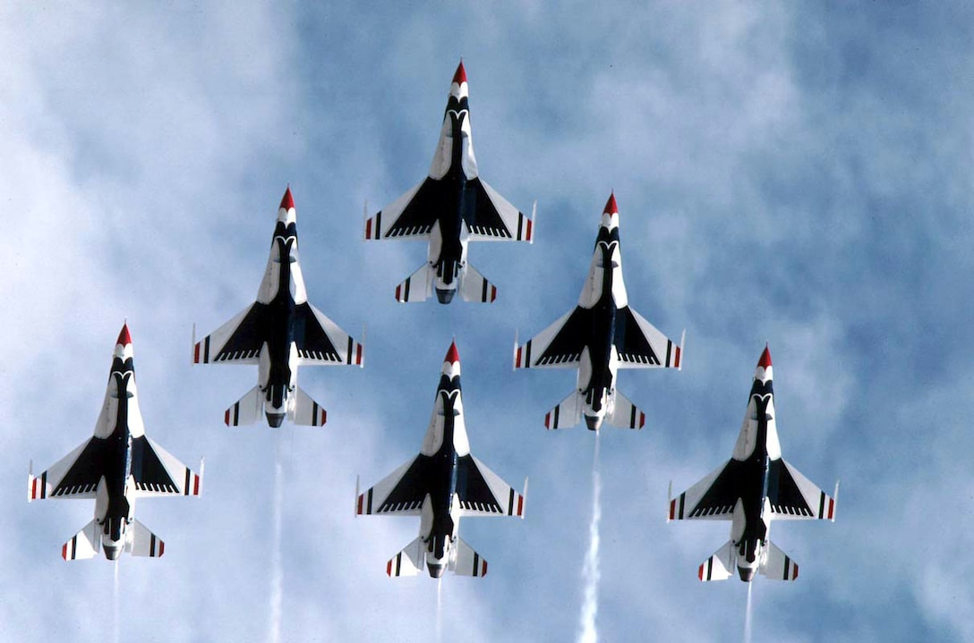 FILE PHOTO -- The U.S. Air Force Air Demonstration Squadron, the Thunderbirds, performs precision aerial maneuvers demonstrating the capabilities of Air Force high performance aircraft to people throughout the world. The squadron exhibits the professional qualities the Air Force develops in the people who fly, maintain and support these aircraft. The Thunderbirds squadron is an Air Combat Command unit composed of eight pilots (including six demonstration pilots), four support officers, three civilians and more than 130 enlisted personnel performing in 25 career fields. The Lockheed Martin (formerly General Dynamics) F-16 Fighting Falcon represents the full range of capabilities possessed by the Air Force's tactical fighters. This highly maneuverable multi-role fighter has proven itself to be one of the world's best precision tactical bombers and air-to-air combat aircraft. The only modifications needed to prepare the aircraft for its air demonstration role are installing a smoke-generating system in the space normally reserved for the 20mm cannon, and the painting of the aircraft in Thunderbird colors. (U.S. Air Force photo)