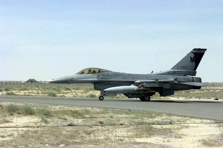 AHMED AL JABER AIR BASE, Kuwait -- An F-16 Fighting Falcon from the 114th Fighter Wing, Joe Foss Field, Sioux Falls, S.D., taxis out on the runway here. (U.S. Air Force photo by Master Sgt. Val Gempis)