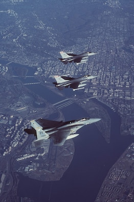 Two Air-Defense Fighter F-16A Fighting Falcons from the North Dakota Air National Guard's 178th Fighter Squadron lead an F-15C Eagle from the 27th Fighter Squadron at Langley Air Force Base, Va., in formation during a combat air patrol mission in support of Operation Noble Eagle. More than 11,000 airmen -- the majority Air National Guard and Air Force Reserve -- have generated more than 7,500 sorties to patrol American skies 24/7 since Sept. 11, 2001. (U.S. Air Force photo by Staff Sgt. Greg L. Davis)