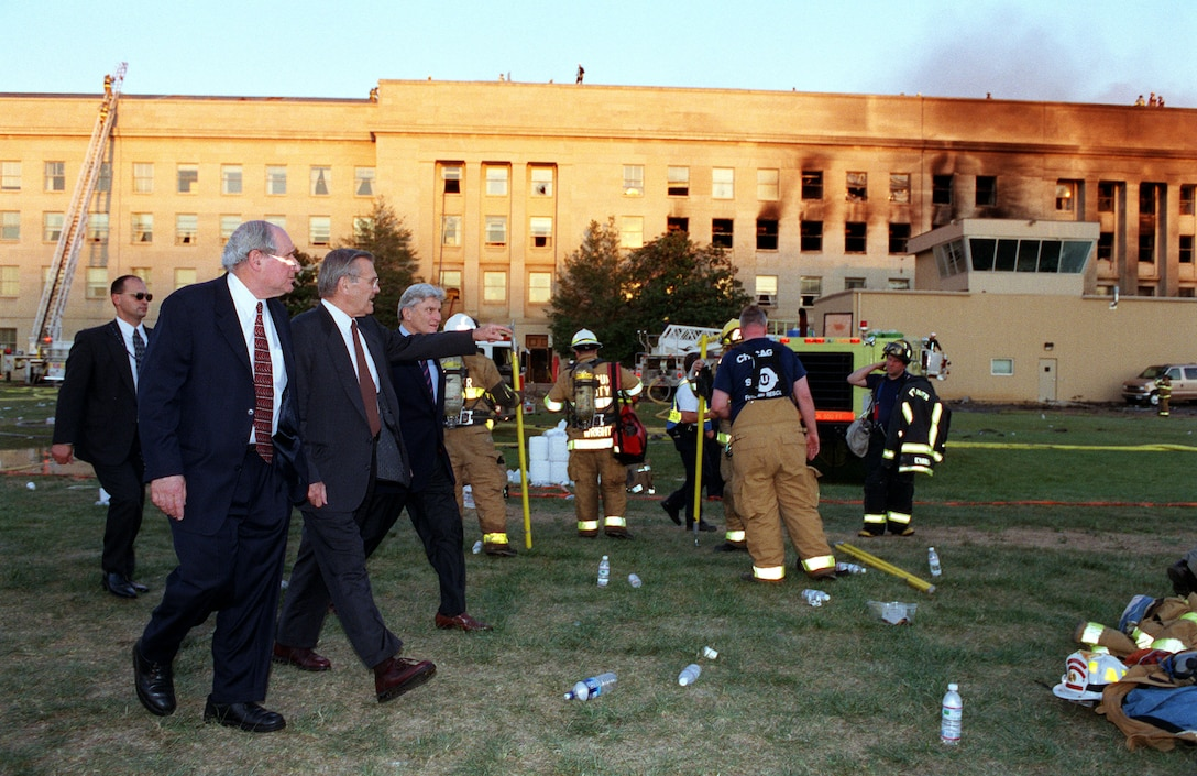 WASHINGTON -- Secretary of Defense Donald H. Rumsfeld (center) leads Sen. Carl Levin (left), D-Mich. and Sen. John Warner (right), R-Va., to the crash scene at the Pentagon heliport on Sept. 11, 2001.  Rumsfeld earlier conducted a news conference with reporters in the Pentagon briefing room on the terrorist attack of the Pentagon.  (DOD photo by Helene C. Stikkel)