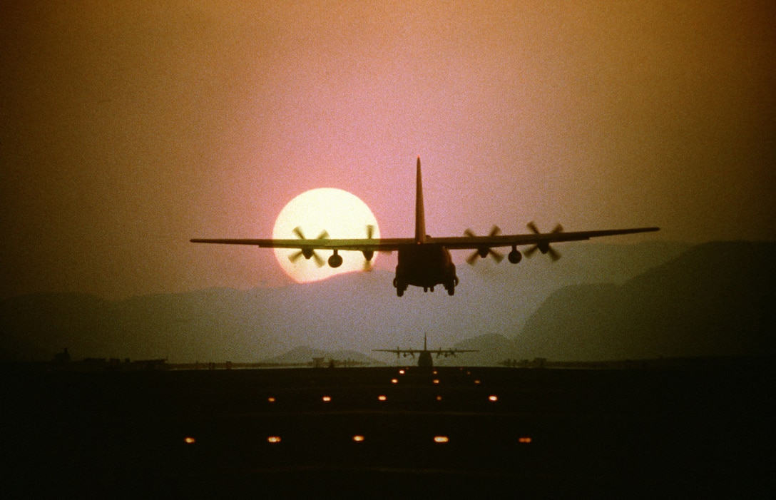 CLARK AIR BASE, Phillippines -- Silhouetted by the setting sun, a C-130 Hercules aircraft prepares to land during a 10-ship air drop exercise being conducted by the 21st Tactical Airlift Squadron, 374th Tactical Airlift Wing. (U.S. Air Force photo by Staff Sgt. Daniel C. Perez.)
