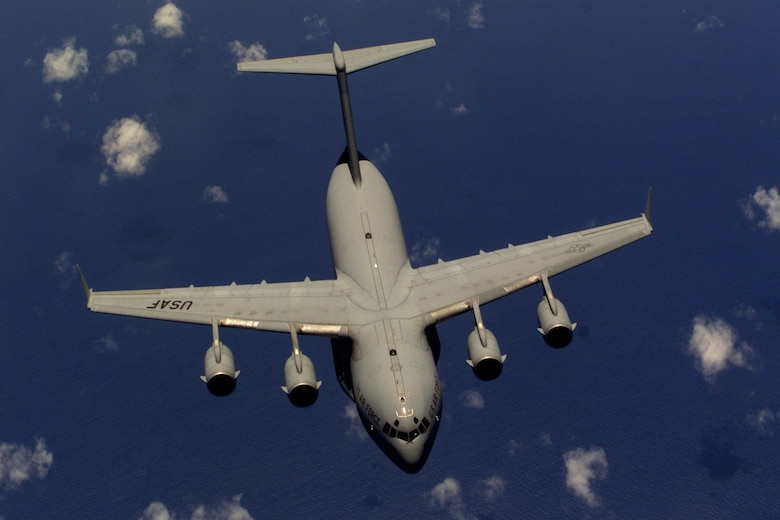 NORTH CAROLINA -- A C-17 Globemaster III from the 437th Air Wing, Charleston Air Force Base, S.C., flies away from a KC-10 Extender after being refueled off the coast of North Carolina.  During Rodeo 2000, teams from all over the world will compete in areas including airdrop, aerial refueling, aircraft navigation, special tactics, short field landings, cargo loading, engine running on/offloads, aeromedical evacuations and security forces operations. (U.S. Air Force photo by Staff Sgt. Sean M. Worrell)
