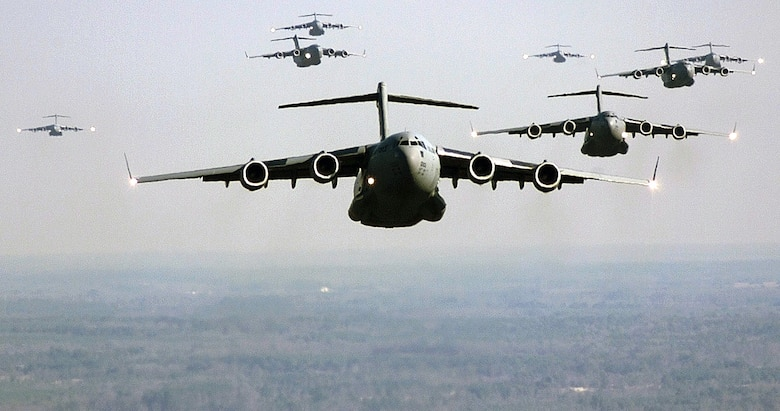OVER NORTH FIELD, S.C. -- A C-17 Globemaster III from Charleston AFB, S.C., leads a formation Jan. 12, 2000.  The C-17 is part of a nine-ship formation flying a training mission that includes an air drop, a short field landing and aerial refueling. (U.S. Air Force photo by Staff Sgt. Jeffrey Allen)