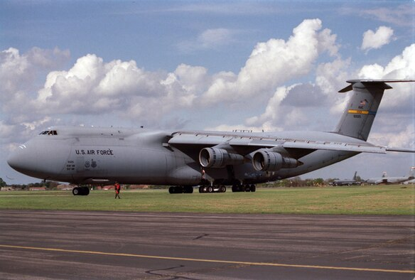 ROYAL AIR FORCE, MILDENHALL, England -- A Force C-5 Galaxy arrives at here, April 22, 1999. The C-5 is delivering four fuel trucks to help the fuels management flight of the 100th Supply Squadron keep up with the increasing demand to fuel more KC-135R Stratotankers for Operation Allied Force. (U.S. Air Force photo by Tech. Sgt. Brad Fallin)
