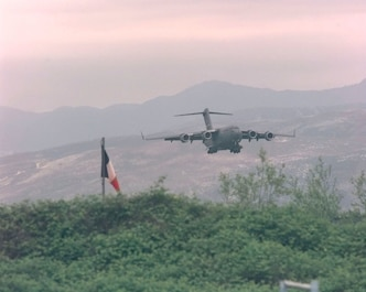 A U.S. Air Force C-17 Globemaster III from Joint Base Charleston makes its final approach to Rinas Airport in Albania during operation SHINING HOPE, April 23, 1999. Medical Airmen provided humanitarian support for ethnic Albanian refugees fleeing Kosovo.  (U.S. Air Force photo by Tech. Sgt. Cesar Rodriguez)