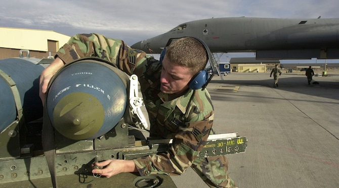 ELLSWORTH AIR FORCE BASE, S.D. -- Senior Airman Phillip Knight from Sunnyvale, Calif., a weapons loader with the 77th Bomb Squadron, here prepares an inert 2,000 pound Joint Direct Attack Munition.  JDAMs use the global positioning system for precision guidance. Iraq and other potential adversaries may have the ability to jam GPS signals, but Air Force war planners are not too worried about the effect of jamming on precision munitions (U.S. Air Force photo by Master Sgt. Dave Nolan)