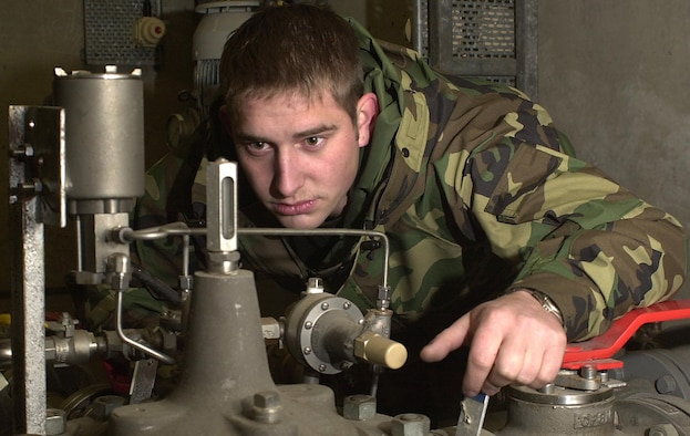 ROYAL AIR FORCE MILDENHALL, England -- Senior Airman Johnathan Seifert inspects a gauge that indicates the operational status of the fuel system. Seifert is assigned to the 100th Logistics Readiness Squadron's fuels management flight here. The flight provides nearly 33 million gallons of fuel annually to the 100th Air Refueling Wing's KC-135 Stratotankers, 352nd Special Operations Group aircraft and transient aircraft that visit the base. (U.S. Air Force photo by Tech. Sgt. Michael D. Morford)