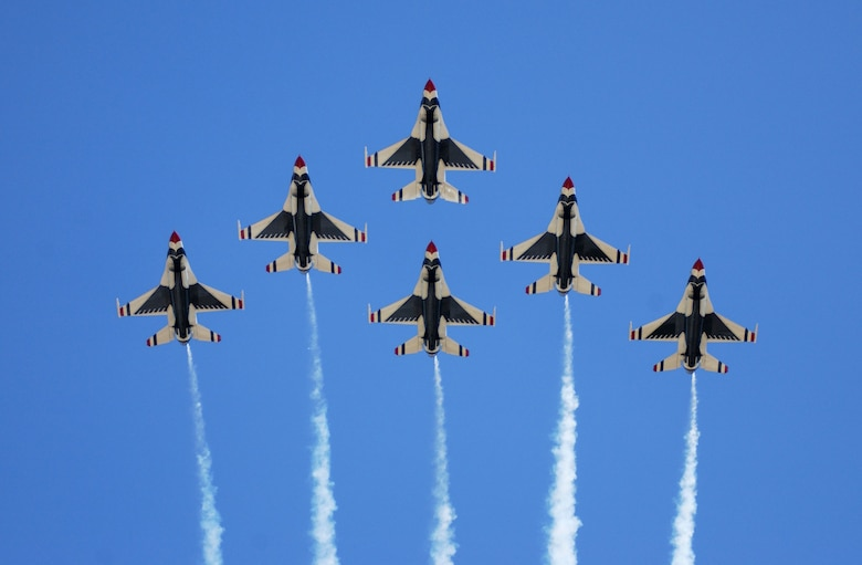 SIOUX FALLS S.D. -- The U.S. Air Force Thunderbirds perform a 6-ship formation fly over during a 2003 airshow.  The team performs precision aerial maneuvers to exhibit the capabilities of modern high-performance aircraft to audiences throughout the world.  (U.S. Air Force photo by Senior Airman Michael Frye)