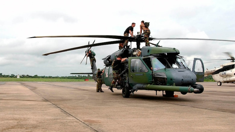 LUNGI, Sierra Leone -- Airmen from the 85th Maintenance Squadron check an Air Force HH-60G Pave Hawk helicopter following a mission July 21.  The mission flew 41 Marines with an antiterrorism security team to the U.S. Embassy at Monrovia, Liberia.  The airmen are part of the 398th Air Expeditionary Group providing recovery and emergency evacuation in Liberia.  The 85th MXS is deployed from Naval Air Station Keflavik, Iceland.  (U.S. Air Force photo by Tech. Sgt. Justin D. Pyle)