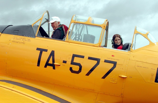 MAXWELL AIR FORCE BASE, Ala. (AFPN) -- Retired Brig. Gen. Chuck Yeager and Young Eagle Danielle Orcutt, 12, taxi down the flightline in a World War II-vintage AT-6 Texan aircraft here June 7.  (U.S. Air Force photo by Carl Bergquist)