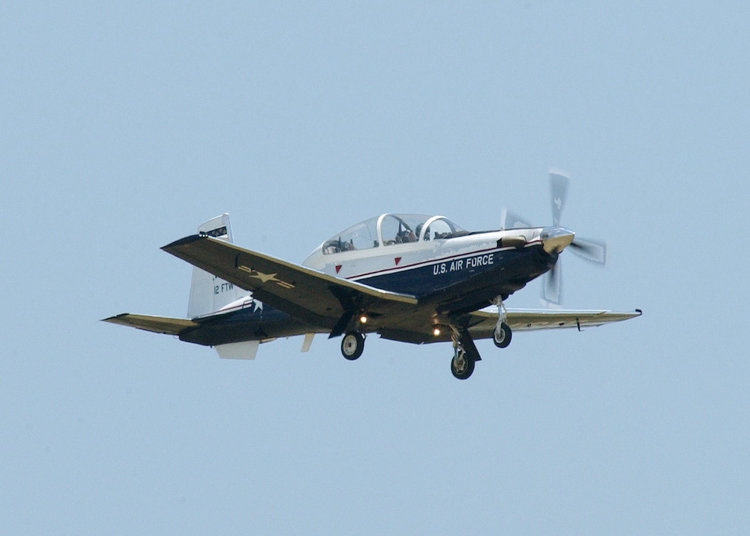 "RANDOLPH AIR FORCE BASE, Texas -- The T-6A Texan II performs a ""gear down"" pass.  The Texan is a single-engine, two-seat primary trainer designed to train Joint Primary Pilot Training, or JPPT, students in basic flying skills common to U.S. Air Force and Navy pilots. The trainer is phasing out the aging T-37 fleet throughout Air Education and Training Command.  (U.S. Air Force photo by O.J. Sanchez)"
