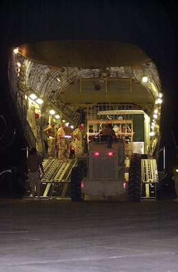 TALLIL AIR BASE, Iraq -- Airmen unload one of three planes of equipment and materials for the 1st Expeditionary Red Horse Group on June 26.  The engineering team will spend three weeks repairing the runways so heavy aircraft can land here.  (U.S. Air Force photo by Master Sgt. Deb Smith)