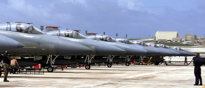 ANDERSEN AIR FORCE BASE, GUAM -- A row of F-15 Eagles, deployed from Kadena Air Base, Japan, for exercise Tandem Thrust 03, line up before takeoff April 24.  The exercise is a joint endeavor conducted in the Marianas Islands including forces from the U.S., Canada and Australia. (U.S. Air Force photo by Photo by Airman 1st Class Abby M. Young)