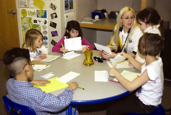 """HILL AIR FORCE BASE, Utah -- Children write letters as part of the """"Journey Around the World"""" program sponsored by the youth center here.  Letter writers get the chance to make friends with others their age who live on Air Force bases worldwide.  (Courtesy photo)"""