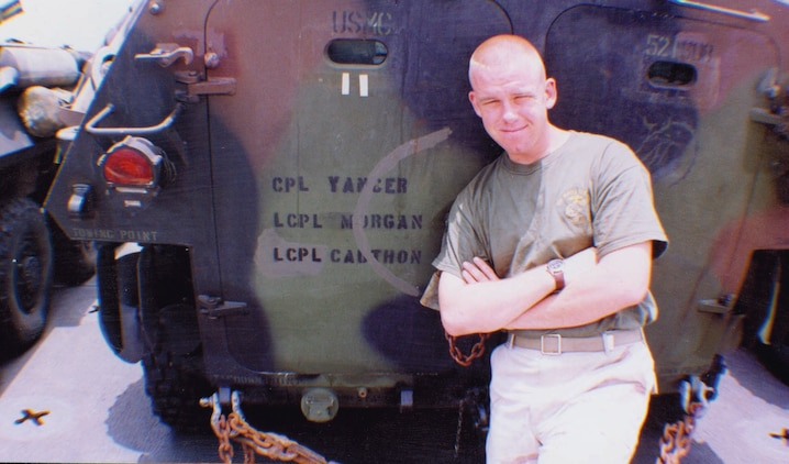 Lance Cpl. Gary Morgan stands next to the light armored vehicle he traveled in during his first deployment to Iraq in 2003.  The 27-year-old Civilian Marine left the Corps in 2004, but continues to serve by repairing the LAVs at Maintenance Center Barstow aboard Marine Corps Logistics Base Barstow, Calif.