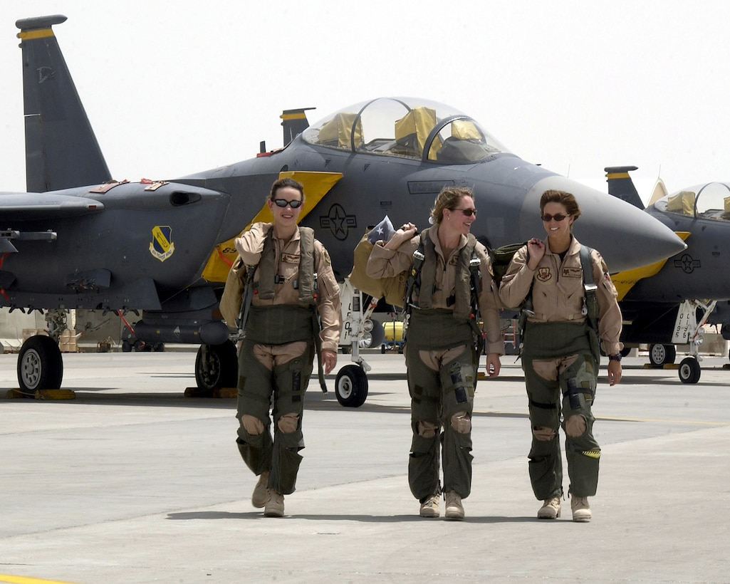 OPERATION IRAQI FREEDOM (AFPN) -- From left to right, 1st Lt. Julie Ayres  and Capts. Mary Melfi and Tally Parham walk down the flightline at a forward-deployed air base in the Middle East on May 3.  The three officers are assigned to the 379th Air Expeditionary Wing and flew combat missions during Operation Iraqi Freedom.  Ayres and Melfi are F-15E Strike Eagle weapons system officers deployed from the 336th Expeditionary Fighter Squadron at Seymour Johnson Air Force Base, N.C.  Parham is an F-16 Fighting Falcon pilot from the 157th Expeditionary Fighter Squadron of the South Carolina Air National Guard at McEntire Air National Guard Base.  (U.S. Air Force photo by Staff Sgt. Derrick C. Goode)