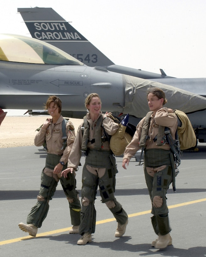 OPERATION IRAQI FREEDOM (AFPN) -- From left to right, Capts. Tally Parham and Mary Melfi and 1st Lt. Julie Ayres walk down the flightline at a forward-deployed air base in the Middle East on May 3.  The three officers are assigned to the 379th Air Expeditionary Wing and flew combat missions during Operation Iraqi Freedom.  Ayres and Melfi are F-15E Strike Eagle weapons system officers deployed from the 336th Expeditionary Fighter Squadron at Seymour Johnson Air Force Base, N.C.  Parham is an F-16 Fighting Falcon pilot from the 157th Expeditionary Fighter Squadron from the South Carolina Air National Guard at McEntire Air National Guard Base.  (U.S. Air Force photo by Staff Sgt. Derrick C. Goode)