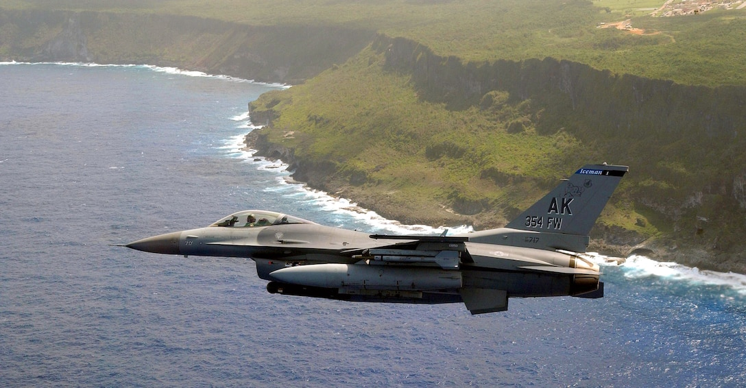 ANDERSEN AIR FORCE BASE, GUAM -- An F-16 Fighting Falcon assigned to the 18th Fighter Squadron, Eielson AFB, Alaska makes its appoach to Andersen AFB, Guam.  The aircraft is participating in Exercise Tandem Thrust '03, conducted in the Mariana Islands. The exercise is a joint endeavor to include forces from the U.S., Canada, and Australia.  (U.S. Air Force photo by Master Sgt. Bill Kimble)