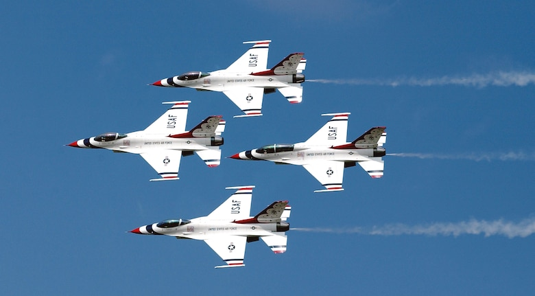 """BARKSDALE AIR FORCE BASE, La. -- The U.S. Air Force Thunderbirds perform at the 2003 """"Defenders of Liberty"""" air show held here May 10-11.  (U.S. Air Force photo by Staff Sgt. Denise A. Rayder)"""