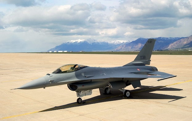 HILL AIR FORCE BASE, Utah (AFPN) -- Italian defense officials accepted the first of 34 modified and refurbished F-16 Fighting Falcon A and B models from Ogden Air Logistics Center experts here May 16.  (U.S. Air Force photo by Todd Cromar)