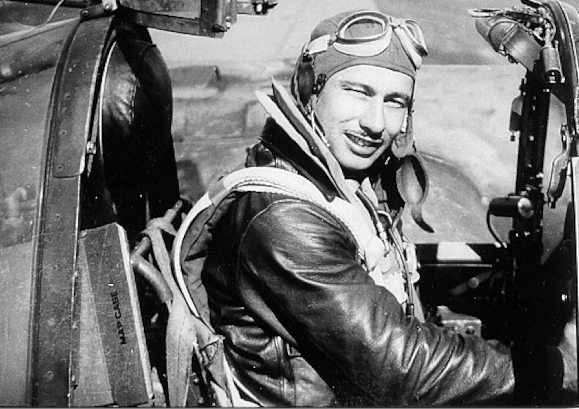1940's -- First Lt. Carl Hoenshell poses in his P-38 Lightning during World War II.  He was declared killed in action in 1945, but his remains were not recovered until 2002.  His family buried him with full military honors in his hometown of Ossowa, Mich., on May 25.
