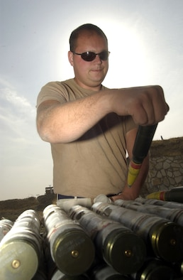 BAGRAM AIR BASE, Afghanistan -- Staff Sgt. Jerrad Oakes prepares to place a 30 mm ammunition round in a loading sleeve so it can be loaded on an A-10 Thunderbolt II for combat here.  Oakes is assigned to the 455th Expeditionary Operations Group and is deployed as part of Air and Space Expeditionary Force Blue from Spangdahlem Air Base, Germany.  Airmen with AEF Silver are replacing those with AEF Blue.  (U.S. Air Force photo by Staff Sgt. Russell Wicke)