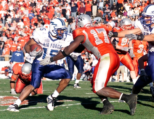 ALBUQUERQUE, N.M. -- Air Force halfback Darnell Stephens cuts upfield to avoid the grasp of New Mexico linebacker Billy Strother.  The junior rushed four times for 27 yards and the team's sole touchdown during Air Force's 24-12 loss to the University of New Mexico Lobos on Nov. 15.  (U.S. Air Force photo by John Van Winkle)