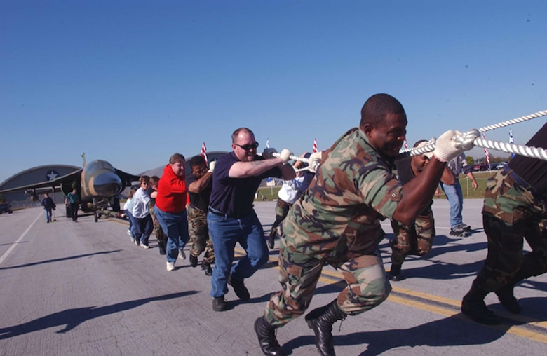 DAYTON, Ohio -- Teams drag a 60,000-pound F-111F fighter jet during the Air Force Museum's fifth annual aircraft pull recently, to see which team can pull it the farthest in 45 seconds.  Twenty-four teams participated, raising nearly $5,000 in Combined Federal Campaign donations.  (U.S. Air Force photo by Jan Lawrence)