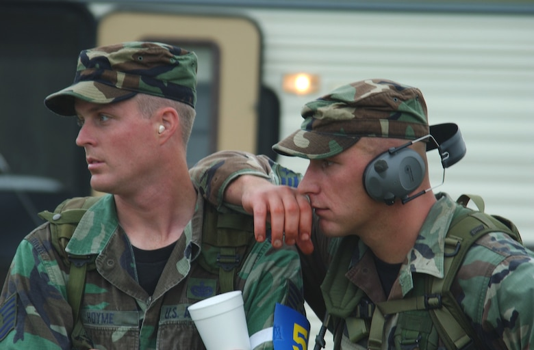 CAMP BULLIS, Texas -- Tech. Sgt. Daniel Hoyme (left) and Senior Airman Brian Patterson of the Air Education and Training Command Defender Challenge 2003 team, watch a team member compete on the handgun range during the Warrior Challenge event.  The AETC team won the Warrior Challenge.  Hoyme is from the 342nd Training Squadron at Lackland Air Force Base, Texas, and Patterson is from the 81st Security Forces Squadron at Keesler AFB, Miss. (U.S. Air Force photo by Chief Master Sgt. Gary Emery)
