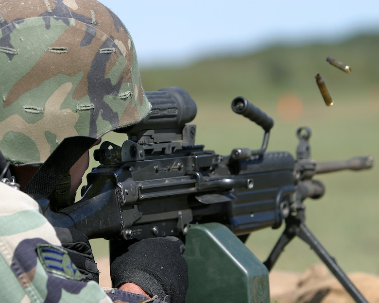 CAMP BULLIS, Texas -- A competitor fires down range during the Combat Rifle event at the Defender Challenge 2003 security forces competition.  The challenge featured 12 all-star security forces teams from Air Force major commands, the British Royal Air Force Regiment and the Department of Energy competing here Oct. 10 to 16.  The defenders from Air Mobility Command took top honors in the Combat Rifle event.  (U.S. Air Force photo by Robbin Cresswell)