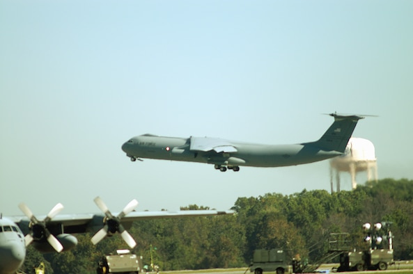 ROBINS AIR FORCE BASE, Ga. -- A C-141 Starlifter, Tail No. 65-0248, departs Oct. 16 following a ceremony to mark the end of C-141 maintenance here.  The Air Force expects to phase the aircraft out of its inventory in 2006.  (U.S. Air Force photo by Sue Sapp)