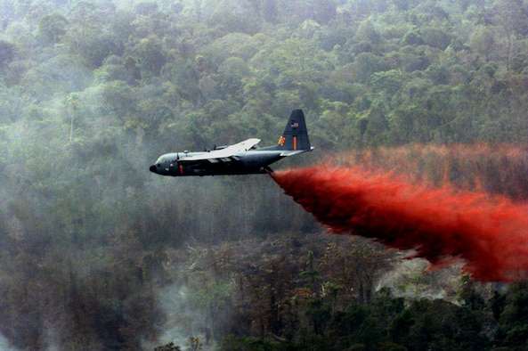 FILE PHOTO -- Air National Guard C-130 Hercules equipped with modular airborne firefighting systems, similar to this one, are dropping thousands of gallons of retardant on the wildfires in Southern California.  The fires have destroyed more than 830 homes and burned out more than 500,000 acres.  California officials said the fires are responsible for at least 15 deaths.  (U.S. Air Force photo by Staff Sgt. Daryl McKamey)