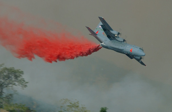 CHANNEL ISLANDS AIR NATIONAL GUARD STATION, Calif. -- An Air Force C-130 Hercules aircraft drops fire retardant on the Simi Fire in Southern California on Oct. 28.  The modular airborne firefighting system-equipped aircraft is assigned to the 146th Airlift Wing here.  (U.S. Air Force photo by Staff Sgt. Alex Koenig)