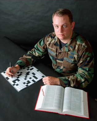 ELMENDORF AIR FORCE BASE, Alaska -- First Lt. Tony Wickman creates military-themed crossword puzzles for base newspapers in his off-duty time.  The puzzles are now being used at bases throughout the Air Force.  Wickman is the deputy chief of Alaskan Command public affairs here.  (U.S. Air Force photo by Senior Airman Joe Laws)