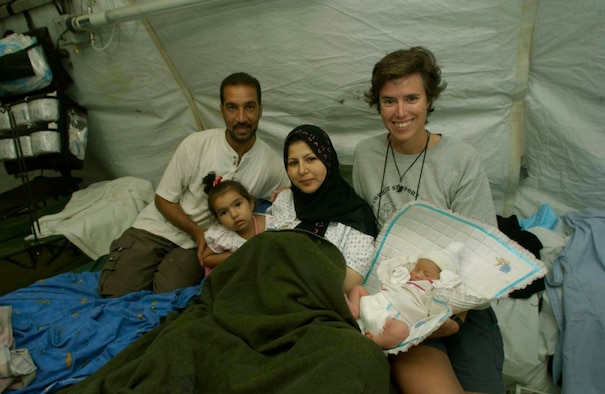 TALLIL AIR BASE, Iraq -- Army Maj. (Dr.) Elizabeth Shanley (right) spends time with the Alrikabi family (left to right) Moslem, Al'aa, Rafah and baby Malach.  Shanley, a physician with the 332nd Expeditionary Medical Group, delivered Malach, the first child born here.  (U.S. Air Force photo by Master Sgt. Lance Cheung)