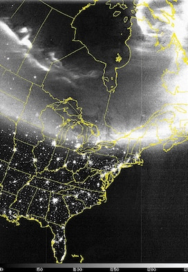 COMPOSITE IMAGE -- This Defense Meteorological Satellite Program satellite network image uses a combination of infrared data with a specialized visual sensor that can see lights at night.  The aurora is seen from the Dakotas through Maine on Oct. 29.  (Courtesy image)