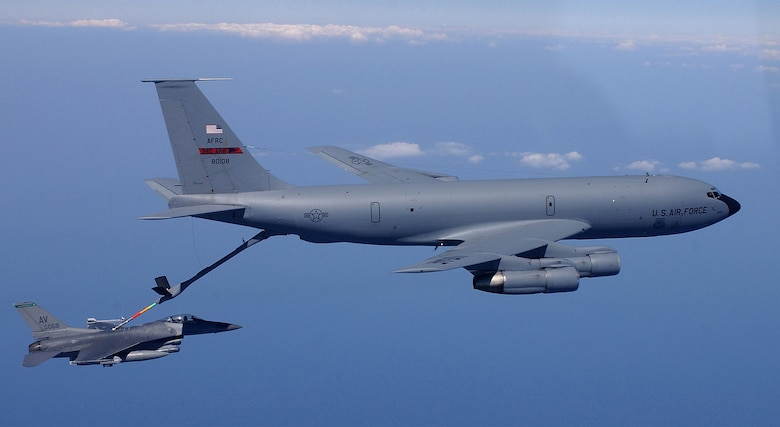FILE PHOTO -- A KC-135 Stratotanker refuels an F-16 Fighting Falcon.  Air Force Secretary Dr. James G. Roche concluded testimony before the Senate Armed Services Committee on Sept. 4.  He answered questions about the 2004 Air Force Tanker Lease Proposal, which would replace ageing KC-135s with leased KC-767s.  (U.S. Air Force photo by Tech. Sgt. Mike Buytas)