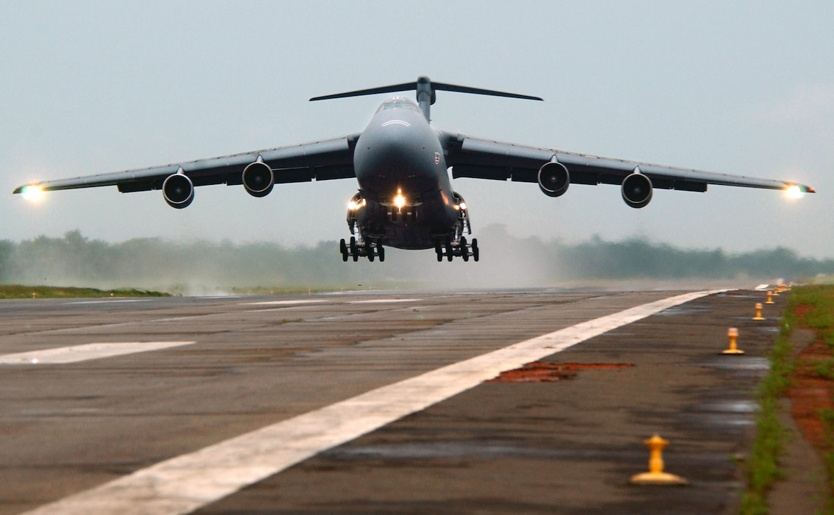 LUNGI, Sierra Leone -- A C-5 Galaxy, with the 301st Airlift Squadron, Travis Air Force Base, Calif., departs for Naval Air Station Keflavik, Iceland, carrying 398th Air Expeditionary Group personnel and equipment that have been supporting efforts in Liberia.  (U.S. Air Force photo by Tech. Sgt. Justin D. Pyle)