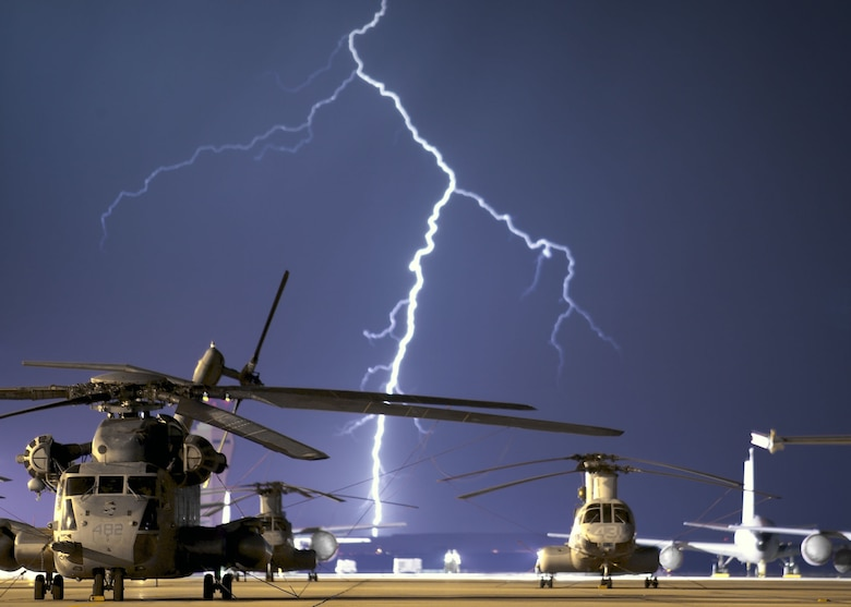 EDWARDS AIR FORCE BASE, Calif. -- Lightning strikes on the horizon behind the flightline here during a thunderstorm Sept. 3.  During the storm, power in some areas of the base was interrupted for a few minutes.  (U.S. Air Force photo by James Shryne)