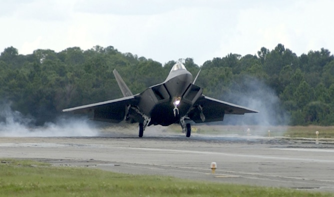 TYNDALL AIR FORCE BASE, Fla. -- The 325th Fighter Wing's first permanently-assigned F/A-22 Raptor lands here Sept. 26.  Tyndall, an Air Education and Training Command installation, was selected to serve as the Air Force's primary F/A-22 training base.  The aircraft was piloted by Lt. Col. Jeff Harrigian, 43rd Fighter Squadron commander here.  (U.S. Air Force photo by Steve Wallace)