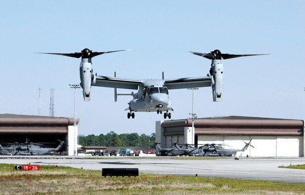 HURLBURT FIELD, Fla. -- A Marine Corps MV-22 Osprey lands here April 2 on its way to an air show at Eglin Air Force Base, Fla.  Air Force Special Operations Command is expected to get 50 CV-22s, an Air Force-modified version of the MV-22, starting November 2006.  Designed to conduct long-range missions, the tilt-rotor aircraft offers increased speed and range over other rotary-wing aircraft.  Two CV-22s are currently at Edwards AFB, Calif., undergoing operational testing.  (U.S. Air Force photo by Staff Sgt. Greg Davis)