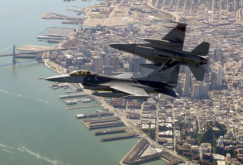 OVER THE SAN FRANCISCO BAY -- Two F-16 Fighting Falcons begin to roll into position for a rapid descent during an Operation Noble Eagle training patrol March 16.  The F-16s are assigned to the California Air National Guard's 144th Fighter Wing in Fresno. (U.S. Air Force photo by Master Sgt. Lance Cheung)