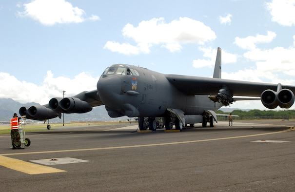 HICKAM AIR FORCE BASE, Hawaii -- A B-52 Stratofortress is prepared for take off on the runway April 6.  Four B-52s arrived here from Andersen Air Force Base, Guam, to escape Typhoon Sudal which missed the island April 7.  The B-52s are deployed to Andersen from Minot AFB, N.D.  (U.S. Air Force photo by Mike Dey)