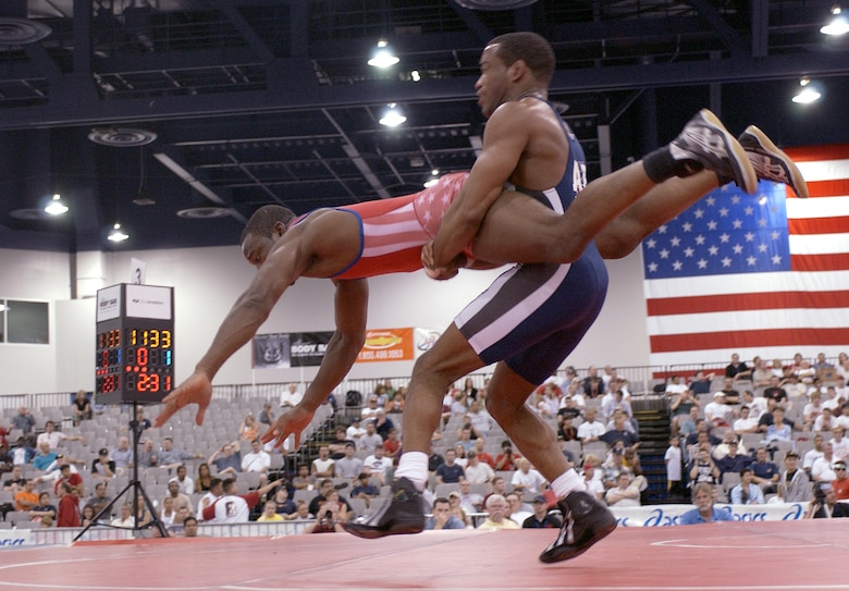 LAS VEGAS -- Steve Woods, 2004 armed forces champion in the 163-pound Greco-Roman wrestling division, spins an opponent during the U.S. National Wrestling Championships here April 9.  Woods took the silver in his division and will represent the Air Force at the U.S. Olympic trials May 21 to 23 in Indianapolis. (U.S. Air Force photo by Airman 1st Class Daniel DeCook)