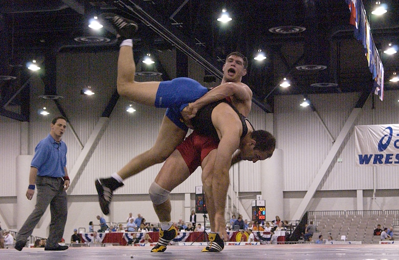 LAS VEGAS -- Philip Johnston, a 211.5-pound-division Greco-Roman wrestler, lifts an opponent during his final match in the 2004 U.S. National Wrestling Championships held here April 9.  Johnston finished seventh in his division.  (U.S. Air Force photo by Airman 1st Class Daniel DeCook)